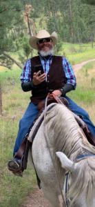 david riding a horse outside in colorado